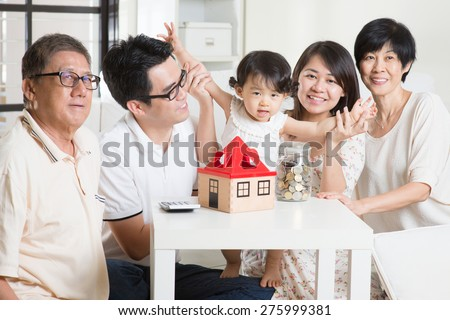 Family money saving or future financial planning concept. Asian multi generations lifestyle at home. - stock photo