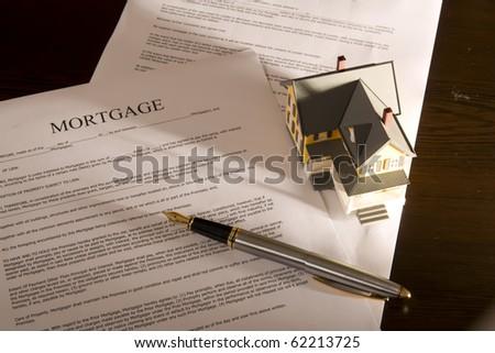 Family mortgage loan statement on desktop - stock photo