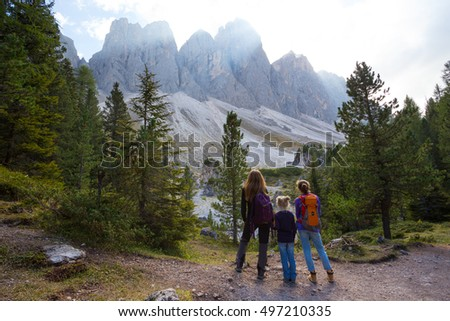 family - mother and daughter hiking at the puez odle nature park. Val Gardena to Alta� Badia. Italy.