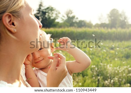Family, mother and son playing and have fun outdoors - stock photo