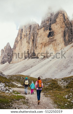 family - mother and two sisters girls hikers at the mountains Dolomites, Italy. Tre Cime di Lavaredo