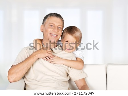 Family. Mother using laptop with daughter standing beside her - stock photo