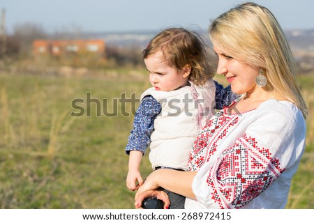 family. mother with daughters outdoors   - stock photo