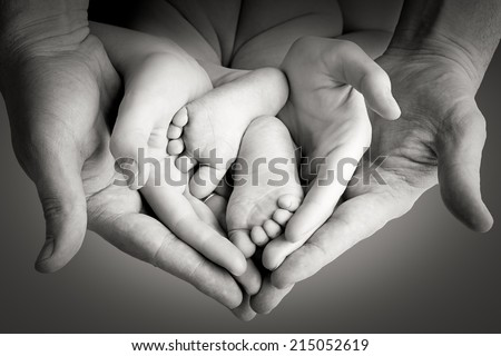Family, mother with father holding baby legs, happy memory - stock photo