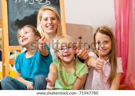Family - mother with her daughters; all of them going to school already - stock photo