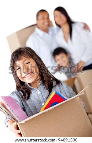 Family moving home and carrying boxes - isolated over a white background - stock photo