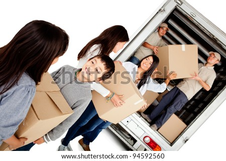 Family moving house and loading a lorry - isolated over a white background - stock photo