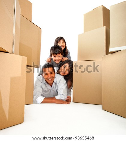 Family moving house with cardboard boxes - isolated over a white background - stock photo