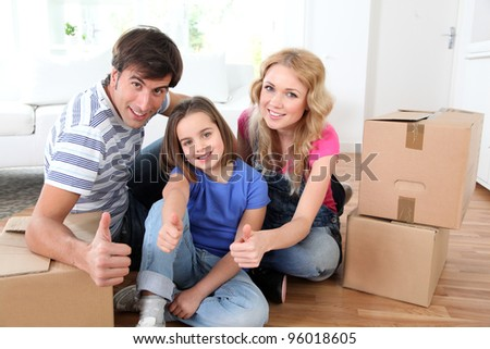 Family moving in new house - stock photo