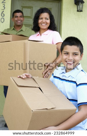 Family Moving in to New House - stock photo