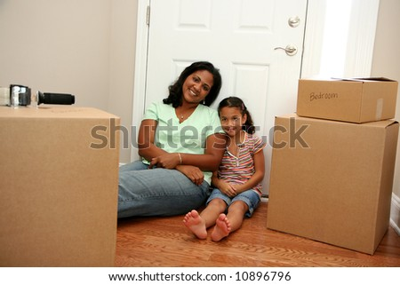 Family moving into a new home - stock photo