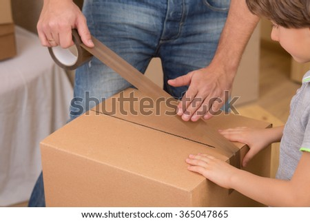 Family moving into a new house - stock photo