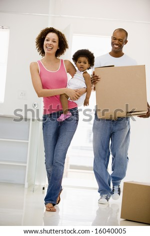 Family moving into new home smiling - stock photo