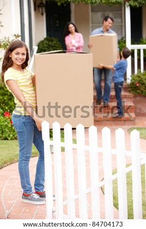 Family moving into new house - stock photo