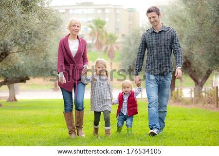 family mum dad and kids - stock photo