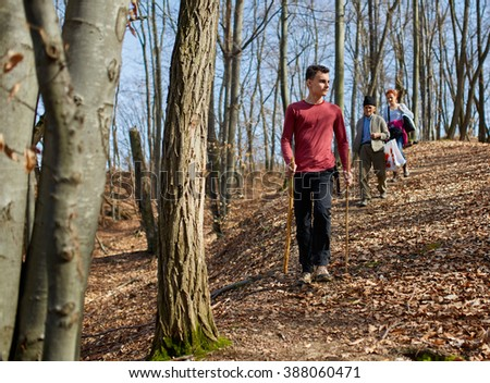 Family of farmers walking home through the forest from the field - stock photo