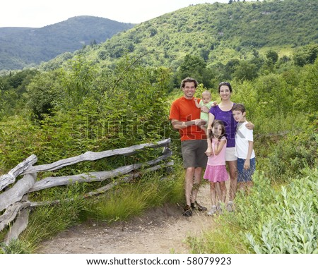 family of five out for hike in mountains - stock photo