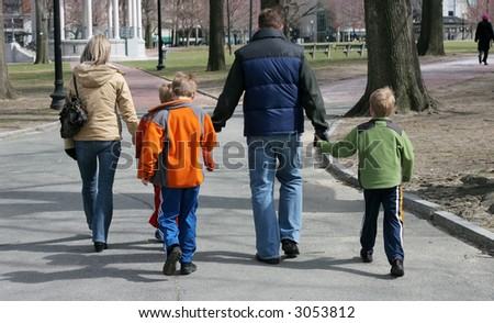 family of five walking in park
