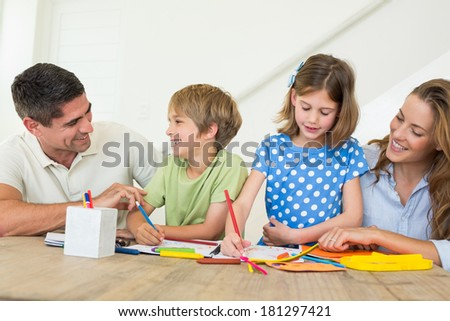 Family of four coloring at home - stock photo