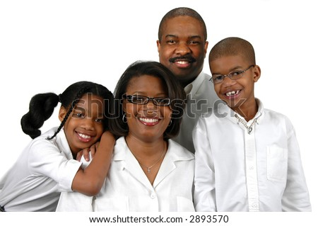 Family of four dressed in white over a white background
