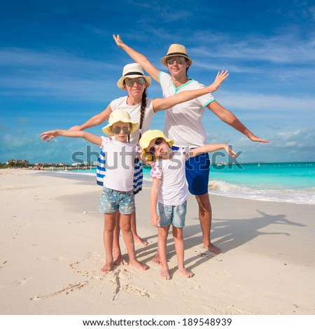 Family of four have fun on caribbean summer vacation