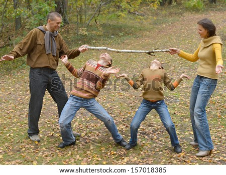 Family of four having fun in summer park - stock photo