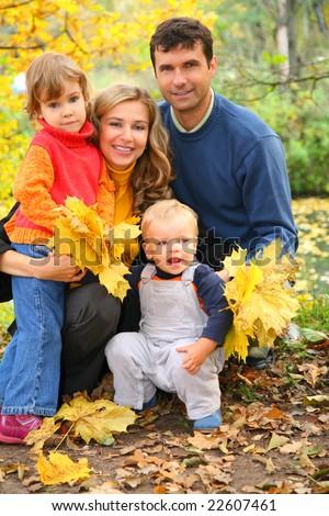 family of four in autumn park - stock photo