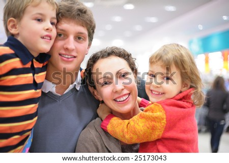 Family of four in shop - stock photo
