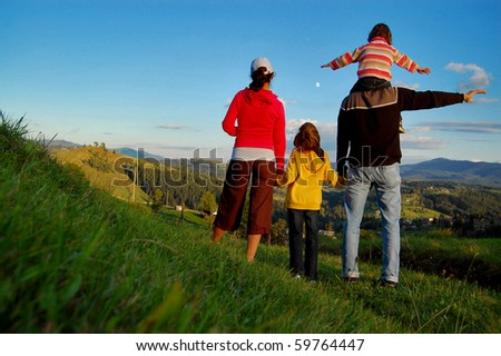 Family of four on their vacation in Carpatian mountains - stock photo