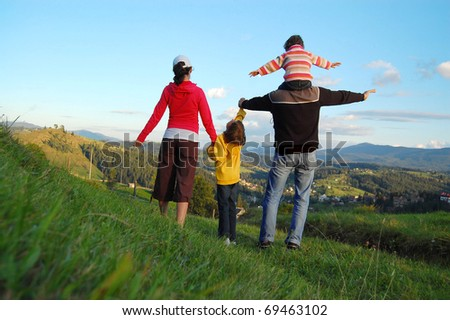 Family of four on their vacation in mountains - stock photo