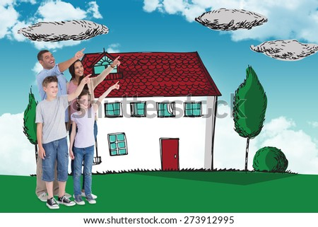 Family of four pointing at copy space against blue sky - stock photo