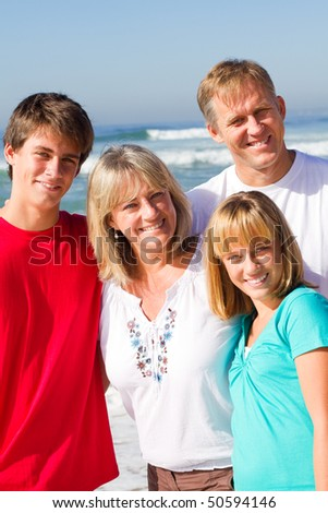 family of four portrait on beach