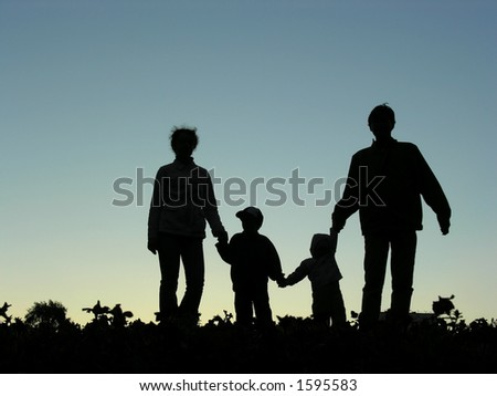 family of four sundown - stock photo