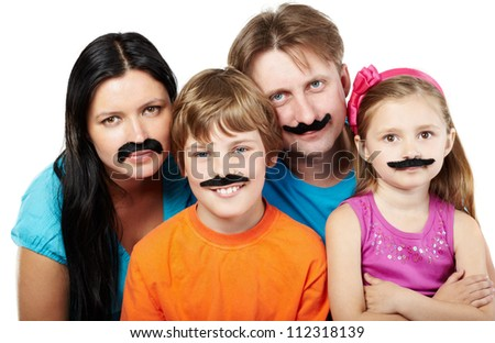 Family of four with glued artificial mustaches. - stock photo