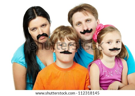 Family of four with glued artificial mustaches.