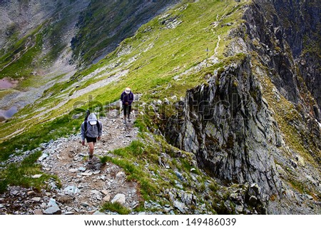 Family of hikers - mother and son, on a mountain - stock photo