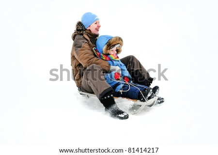 family of mother and kid rolling the sledge - stock photo