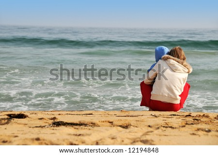 family of mother with baby on the sea beach