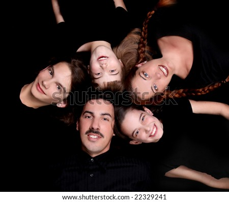 Family of 5 Portrait Lying Down in a Circle on Black