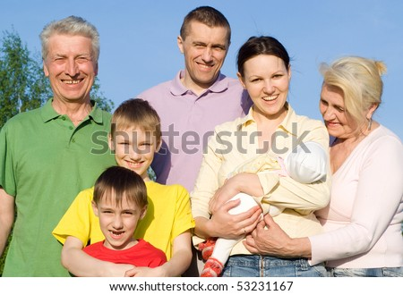 family of seven people on the nature - stock photo