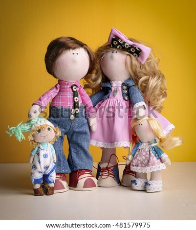 Family of textile dolls.