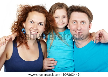 Family of three, father and mother on sides and daughter in center - stock photo