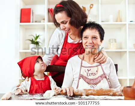 Family of three female generations baking - stock photo
