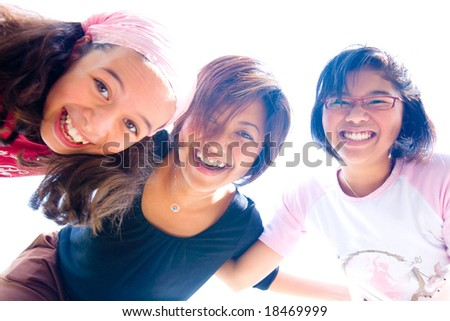 Family of three girls in fun expression playing together