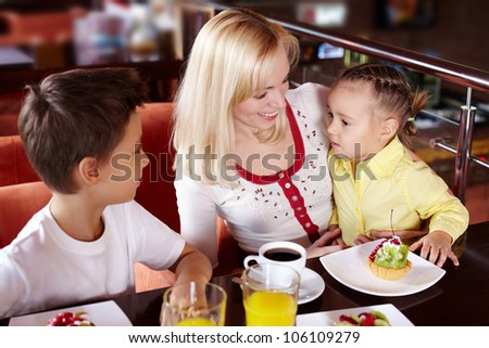 Family of three hanging out at the cafe
