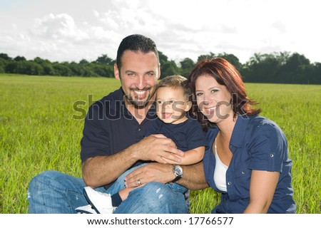 Family of Three in a Meadow