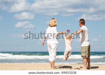 family of three in the Mediterranean - stock photo