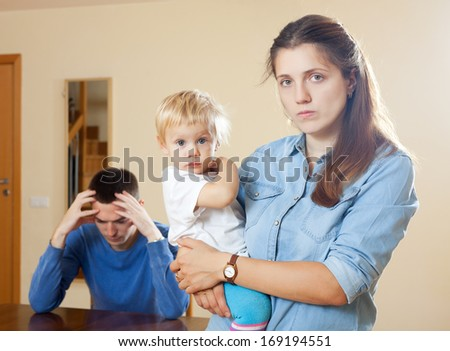 Family of three with child having conflict - stock photo