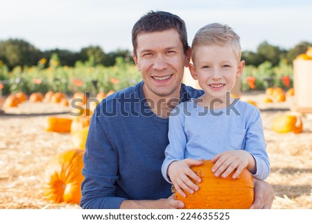 family of two at pumpkin patch