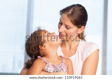 Family of two enjoying each other - stock photo